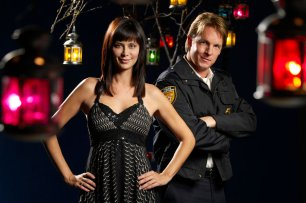 Catherine Bell as Cassie, the enchanted beauty who moves to a small town and charms Police Chief Jake Russell (Chris Potter). .Photo: Brooke Palmer /©Ê2007ÊCrown Media..Catherine Bell (ÒArmy WivesÓ) stars as Cassie, a bewitching woman who moves into a mysterious mansion in a small town.Ê Soon, she opens Bell, Book & Candle, a curiosity shop full of candles, lotions, etc., and is enthralling the children of the local Police Chief (Chris Potter), who believes that she is a witch (but not a bad one!).Ê But not everyone in town is appreciative of their quirky new neighbor, and it may take a little bit of magic for her to truly become part of the community. .