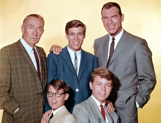 MY THREE SONS - Gallery - Season 5 - 1965 Fred MacMurray (right) stars as widowed aeronautical engineer Steve Douglas, raising his three sons with the help of William Demarest (left) as Uncle Charley. Don Grady (as Robbie Douglas-top center),Barry Livingstone (as Ernie Thompson Douglas -bottom left) and Stanley Livingstone (as Chip Douglas). CREDIT: ABC