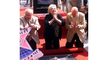 "Actress/singer Rose Marie is gleeful as director Carl Reiner, right, and Honorary Mayor of Hollywood, Johnny Grant, present her with the 2,184th star on the famed Hollywood Walk of Fame Wednesday, Oct. 3, 2001, in the Hollywood section of Los Angeles. Rose Marie is best known for her role as Sally Rogers on the ""Dick Van Dyke show."" (AP Photo/Damian Dovarganes)"